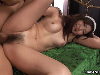 Asian babe getting her wet..