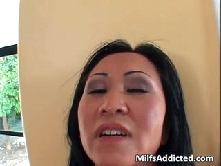 Asian MILF gets her wet pussy fucked
