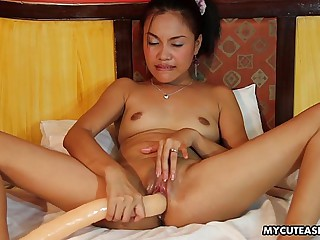 Randy little Asian slut plays with a long sex toy
