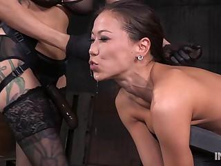 Slender Asian slut fucked hard by lezdom strap on