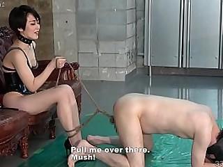 Japanese mistress Minami Nizimura squashing slave's balls